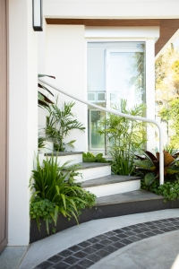 lush planting around a curved stair feature